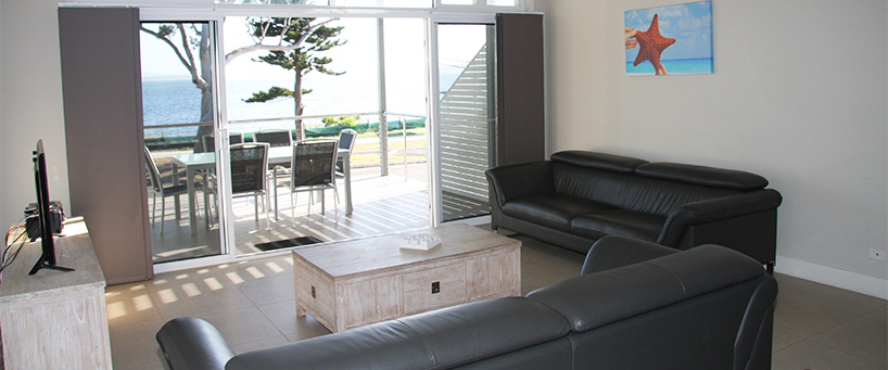 Tidemark Lounge to balcony 2 API Leisure & Lifestyle Holiday Homes 5 Shoal Bay Rd.jpg
