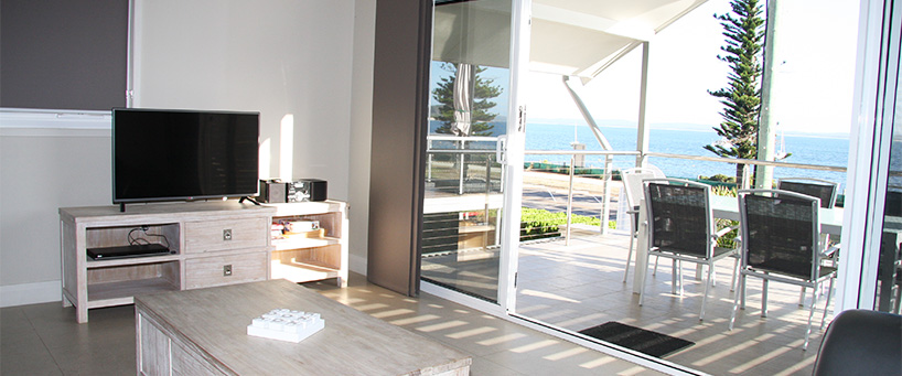Tidemark Lounge to balcony API leisure & Lifestyle Holiday Homes 5 Shoal Bay Rd.jpg